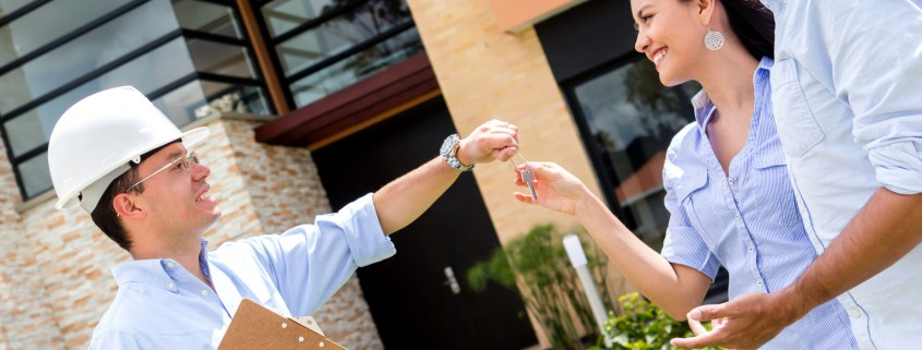 architect-handling-keys-to-a-couple-845x321 Home
